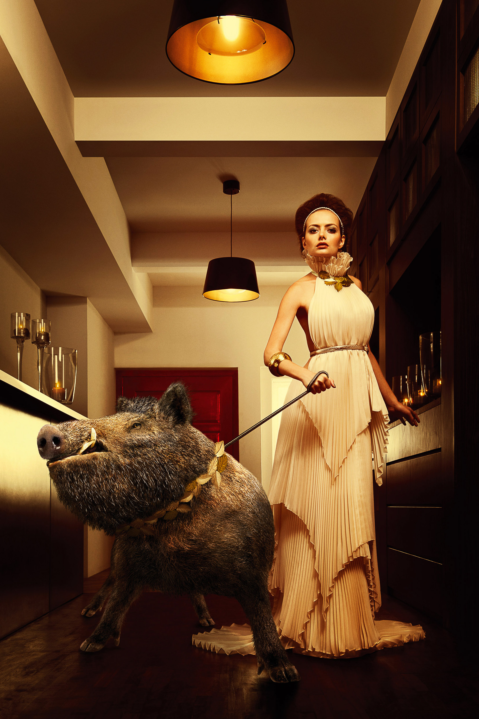 attractive woman with boar on a leash